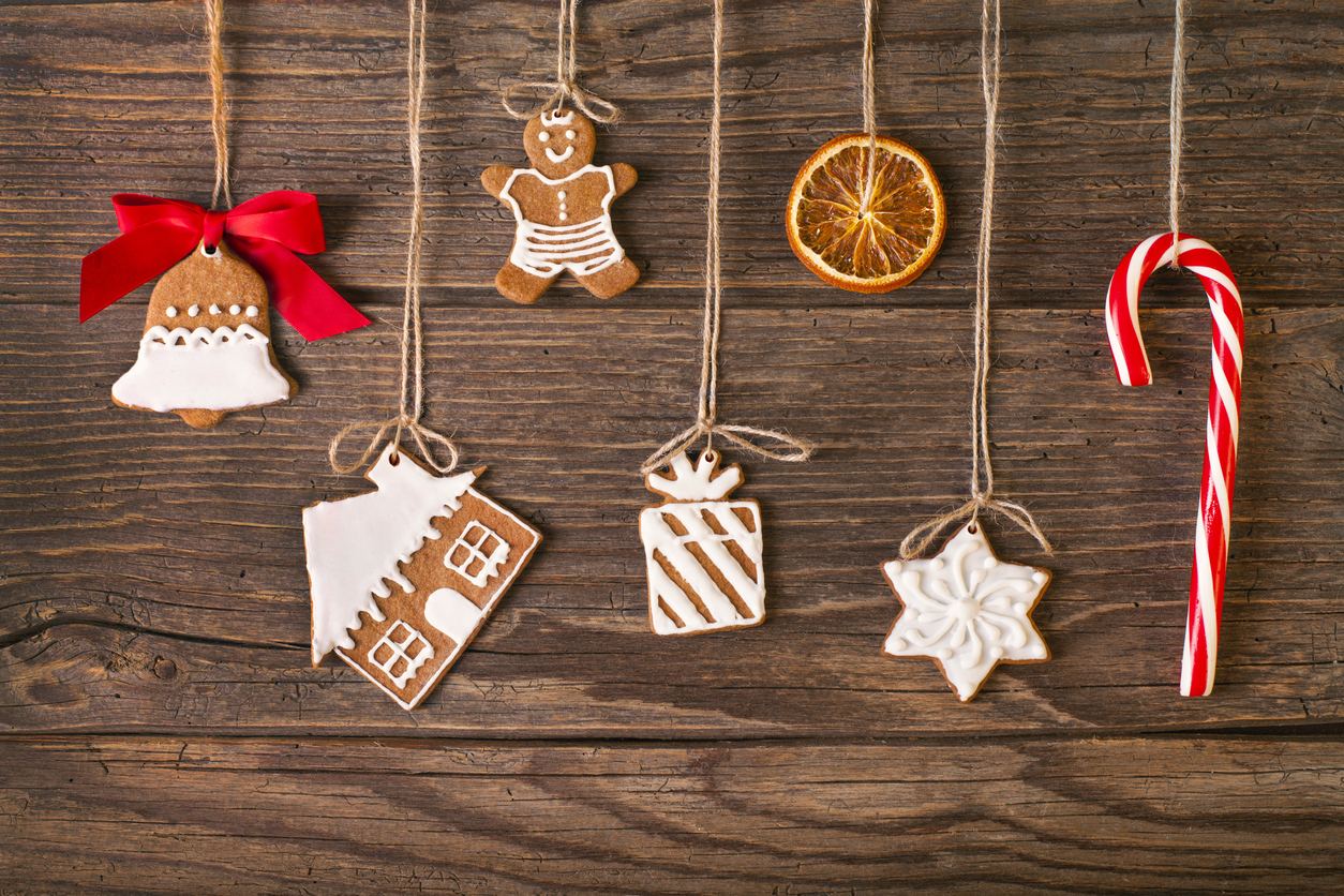 Christmas gingerbread cookies on wood background